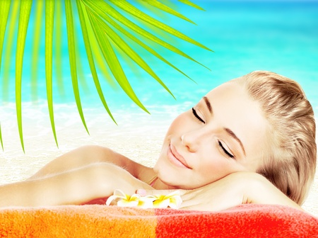 Enjoying spa beach resort, beautiful young adult girl relaxing outdoors, vacation, holidays and travel at summertime photo