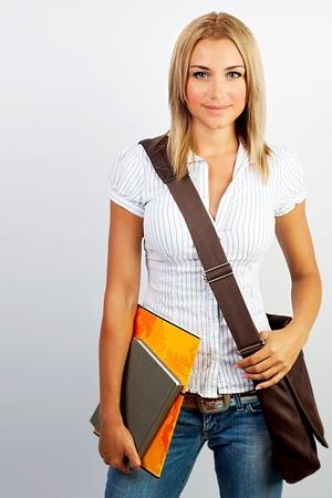 school bag: Chica joven estudiante feliz celebraci�n de libros, estudio, educaci�n, conocimiento, concepto de objetivo