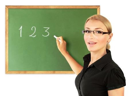classroom teacher: Giovane insegnante di scrivere i numeri sulla lavagna, isolato su sfondo bianco, immagine concettuale di istruzione