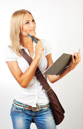 ponder: Cute happy student ponder, holding open textbook, isolated on white background, looking at copyspace, youth lifestyle, education and back to school concept