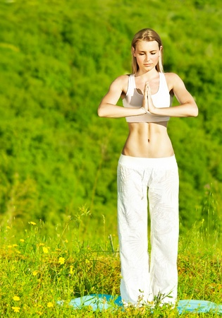 Healthy yoga woman exercising outdoor, fitness, sport and meditation lifestyle concept photo
