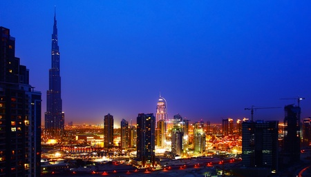 Dubai downtown night scene with city lights, beautiful town, panorama