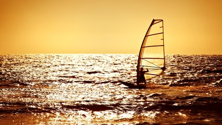watersport: Windsurfer silhouette over sea sunset, panoramic beach landscape, summertime fun, sport, activities, vacation and travel concept
