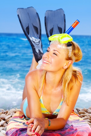 woman diving: Beautiful female closeup portrait on the beach wearing snorkeling equipment, water sport, healthy lifestyle concept