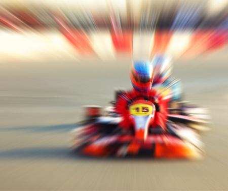 kart: Abstract red slow motion speed background, selective focus on race kart, karting competition, extreme sport