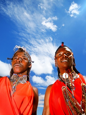 masai: AFRICA, KENYA, MASAI MARA, NOVEMBER 12: portrait on an African  guys of Masai Mara tribe village over blue sky, review of daily life of local people, near to Masai Mara National Park Reserve, November 12, 2008 Kenya Editorial