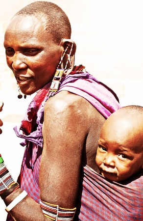 native african ethnicity: AFRICA, KENYA, AMBOSELI, NOVEMBER 5: Amboseli tribe woman with her small baby, portrait of an African family, review of daily life of local people, near to Amboseli National Park Reserve, November,5, 2008 Kenya