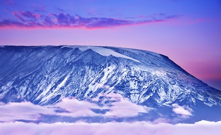 Kilimanjaro at sunset, giant volcano mount, mountain covered with snow, beautiful landscape, Amboseli national park, Kenya, Africa Stock Photo