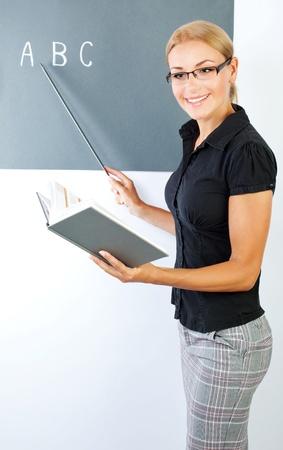 teacher: Retrato de joven maestro, la imagen conceptual de la educaci�n Foto de archivo