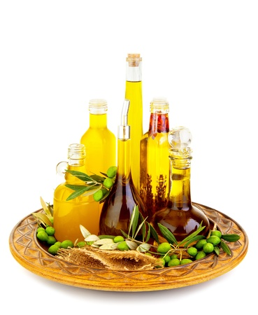 vegetable tray: Variety of an olive oils cans with green fresh olive fruit, isolated on white background, healthy food, traditional italian cuisine