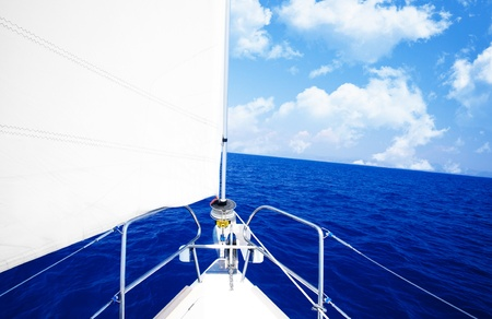 White sailboat at open blue sea, luxury boat parts, extreme sport, freedom concept photo