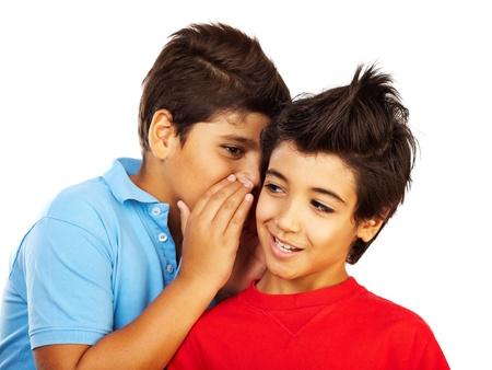 whispering: Teen boys gossip, kids telling secrets, isolated on white background,best friends concept