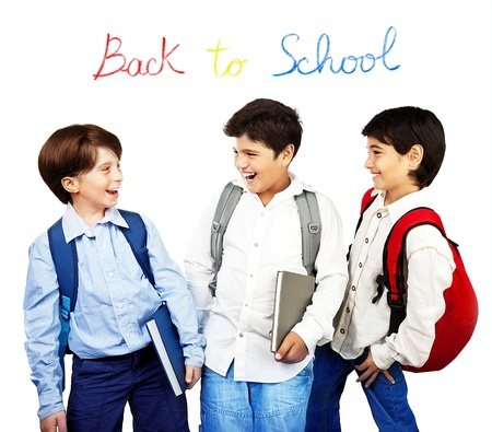 Happy schoolboys laughing, back to school, holding books and talking, isolated on white background, teenage education concept photo