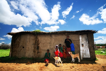 AFRICA, KENYA, MASAI MARA, NOVEMBER 12: portrait on an African  Kids of Masai Mara tribe village smiling to the camera, review of daily life of local people, near to Masai Mara National Park Reserve, November 12, 2008 Kenya