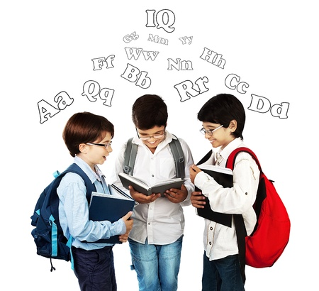 Happy schoolboys reading, back to school, holding books and talking, isolated on white background, teenage education concept photo