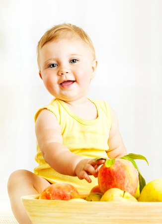 Little baby choosing fruits, closeup portrait, concept of health care & healthy child nutrition photo