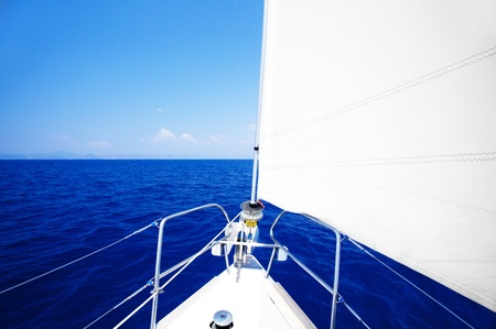 yachting: Sailboat at open blue sea, parts of a luxury boat , extreme sport, freedom concept
