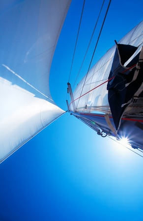 Sail over clear blue sky, sailboat over natural background with sunlight, summertime activities and extreme sport Stock Photo - 10561685