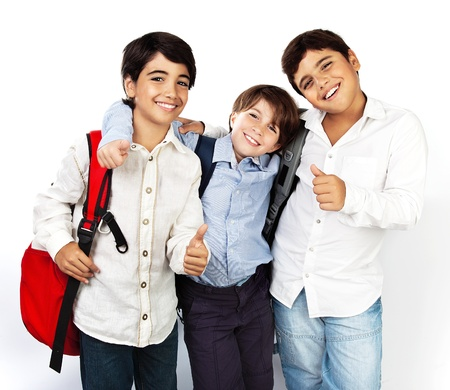 Happy schoolboys with thumbs up, back to school, boys best friends and classmates hugging, smiling, isolated on white background, teenage education concept
