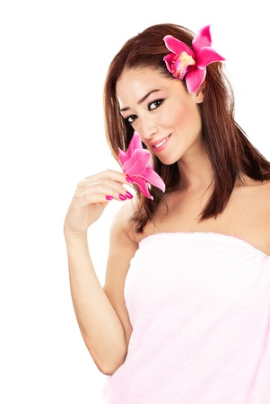 Pretty girl with pink flowers, isolated on white background, spa & relaxation concept Stock Photo - 10585621