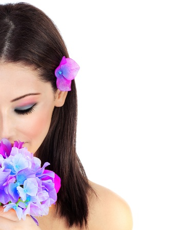 Beautiful young female portrait, hand holding a purple flower, isolated on white background with white text space, beauty and spa concept Stock Photo - 10585619