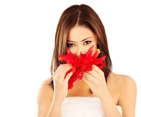 Beautiful young female portrait, holding a red flower, isolated on white background with white text space, beauty and spa concept Stock Photo - 10622652