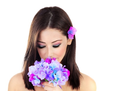 aroma facial: Beautiful young female portrait, holding a purple flower, isolated on white background with white text space, beauty and spa concept Stock Photo