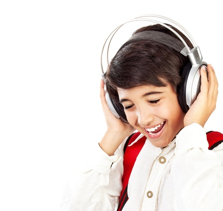 Pretty teen boy enjoying music, holding head with headphones, expressing pleasure and having fun, singing a song photo