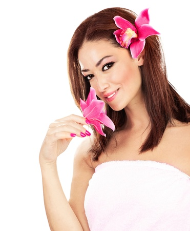 Pretty girl with pink flowers, isolated on white background, spa & relaxation concept photo