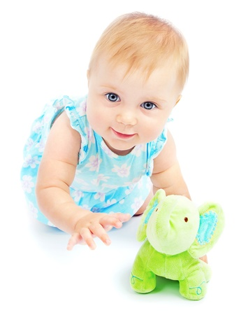 crawl: Adorable happy little baby girl, crawling and playing in the studio, isolated on white background, children day care