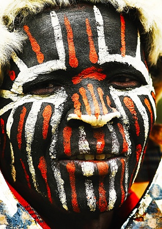 AFRICA, KENYA, NAKURU, NOVEMBER 9: Portrait of a Kenyan warrior with traditionally painted face, review of daily life of local people, near to Lake Nakuru National Park Reserve, November 9, 2008, Kenya
