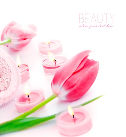 pink tulips: Spa candle with pink tulip flowers, aromatherapy day spa salon, relaxation and beauty treatment concept, objects isolated over white background with text space