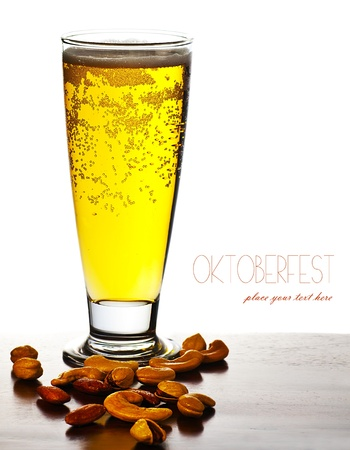 Glass of cold beer drink isolated over white background with text space, festival of beer, autumn traditional german holiday celebration, oktoberfest photo