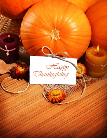 Thanksgiving holiday, pumpkin border still life decoration with candles on the wooden table background, greeting card with text space, harvest concept Stock Photo