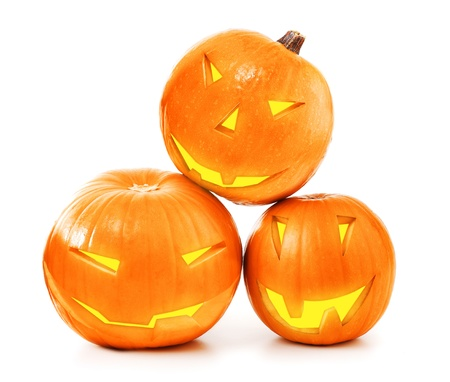 Halloween glowing pumpkins isolated on white background, traditional spooky jack-o-lantern, american autumn holiday photo
