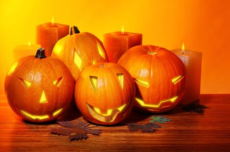 Halloween pumpkin with candles, warm autumn holiday background, traditional jack-o-lantern, night party decoration photo