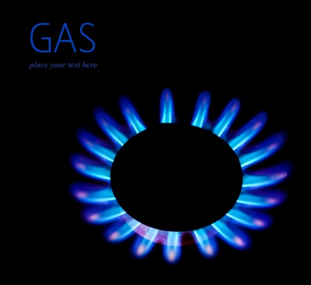 Gas blaze blue flower, isolated on black background with text space, industrial concept, consumption of natural resources photo