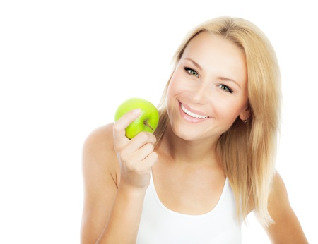 sweet tooth: Happy woman dieting, pretty girl eating apple, female hand holding green fruit, healthy lifestyle, nutritious organic food, isolated on white background with text space Stock Photo