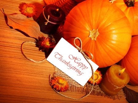Thanksgiving holiday, pumpkin border still life decoration with candles on the wooden table background, greeting card with text space, harvest concept photo