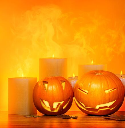 Halloween pumpkins holiday border, with candles and smoke, traditional jack-o-lantern over warm yellow light, night party decoration, fun concept photo