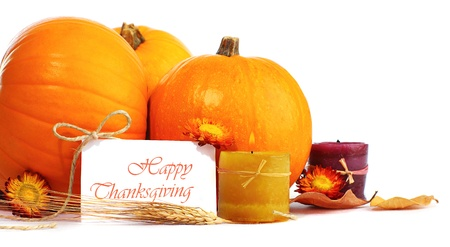 thanksgiving harvest: Thanksgiving holiday, pumpkin border still life decoration with candles isolated over white background, greeting card with text space, harvest concept Stock Photo