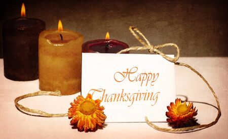 thanksgiving background: Thanksgiving holiday greeting card, still life decoration with candles over dark grunge background
