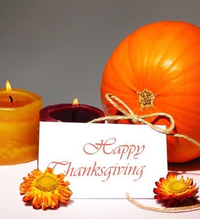 Thanksgiving holiday, pumpkin still life decoration with candles on the table, greeting card with text space, harvest concept photo
