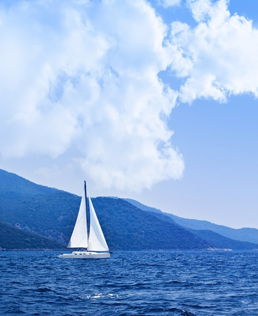 yacht race: Sailboat at open sea, beautiful nature background, blue color landscape, freedom concept