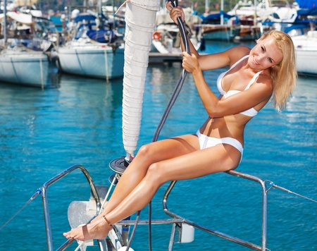 sexy body: Happy female tourist, having fun on sailboat, summertime sailing vacation, beautiful woman outdoor, sexy fit body lady, blonde in bikini