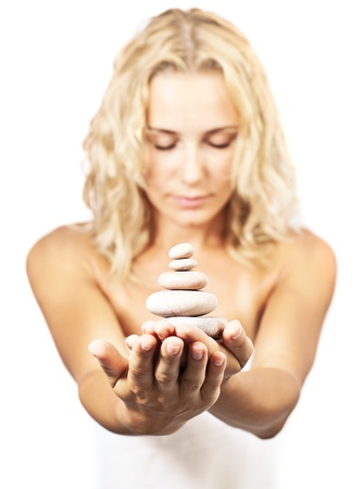 Zen spa stones in hands of young woman, balance and meditation concept, beauty treatment, female portrait with selective focus photo
