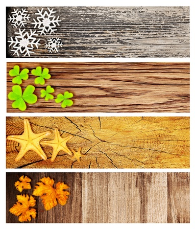 Four season wooden banners, collage of abstract natural backgrounds with seasonal symbols, life cycle concept photo