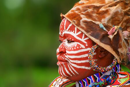 african warriors: Portrait of an African woman with traditionally painted face Editorial