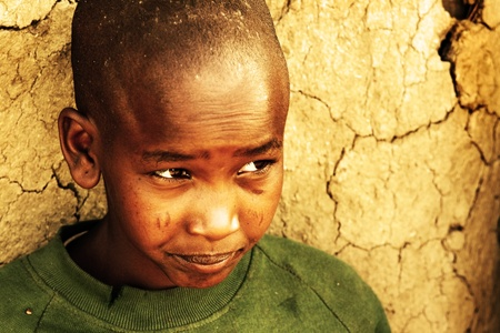 or hungry: Portrait of an African kid, Masai Mara, Kenya