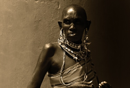 poor african: Portrait of an African lady that dressed traditionally, sepia toned Editorial